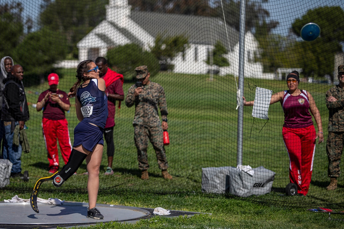 U.S. Marine Corps veteran Annika Hutsler throws a discus during the 2020 Marine Corps Trials competition at Marine Corps Base Camp Pendleton, California, March 5, 2020. The Marine Corps Trials promotes rehabilitation through adaptive sports participation for recovering service members and veterans all over the world.