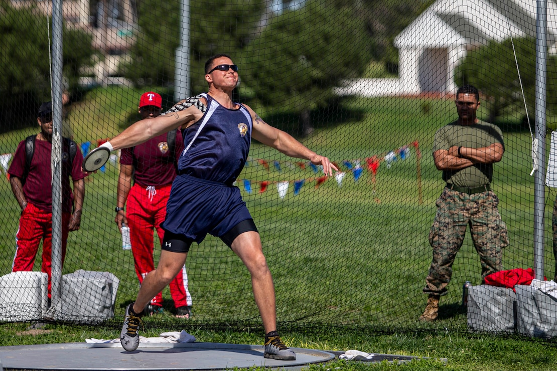 U.S. Marine Gunnery Sgt. Dorian Gardner, the Communication Strategy and Operations chief with Marine Corps Installations West, throws a discus during the 2020 Marine Corps Trials competition at Marine Corps Base Camp Pendleton, California, March 5, 2020. The Marine Corps Trials promotes rehabilitation through adaptive sports participation for recovering service members and veterans all over the world.