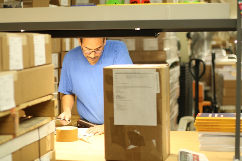 DLIELC Logistics employee, Mr. Ernest Banda, prepares the shipment of course materials for the Vietnam MTT. All course materials were created, designed, and printed in-house. In FY19, DLIELC sent materials to over 160 countries.