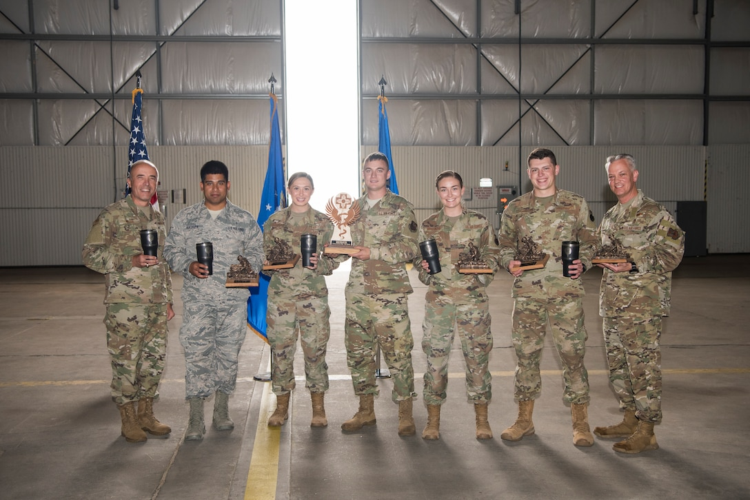 Medical technicians from Cannon Air Force Base, N.M., hold their trophies for second place at the 2019 Medic Rodeo closing ceremonies at Cannon Air Force Base, Sept. 20, 2019. Airman 1st Class Sinéad Brosnan, 27th Special Operations Health Care Operations Squadron aerospace medical technician, led her team and lost only by a tenth of a point. (U.S. Air Force photo by Staff Sgt. Michael Washburn)