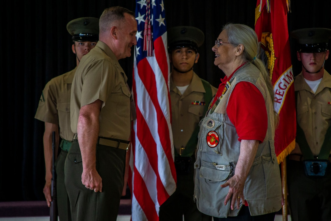 Mrs. Barbara Mathews is bestowed the title of honorary United States Marine by Maj. Gen. William M. Jurney, commanding general, 3rd Marine Division, III Marine Expeditionary Force, during an Honorary Marine ceremony, Marine Corps Base Hawaii, March 6, 2020. The Honorary Marine title is designed to reinforce the special bond between the American people and the Marine Corps by recognizing individuals in the civilian community who have made extraordinary contributions to the Marine Corps. Mrs. Mathews earn this prestigious honor for volunteering over 10 years of her personal time, talents and money capturing photo and video of hundreds of Marine Corps ceremonies, including memorials and special events surrounding the wars in Iraq and Afghanistan. (U.S. Marine Corps photo by Cpl. Matthew Kirk)