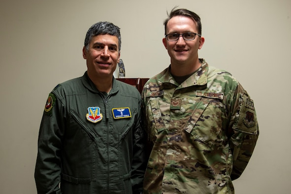 Photo of two Airmen posing for a photo.