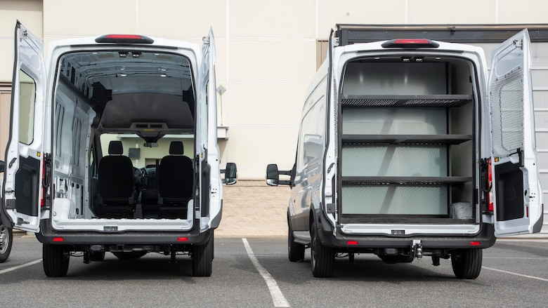 A transit van, stripped of interior, is parked next to a modified transit van March 5, 2020, at Fairchild Air Force Base, Washington.
