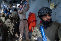 An operator with the United Arab Emirates' (UAE) Critical Infrastructure and Coastal Protection Agency waits for a signal to advance while conducting Visit, Board, Search, and Seizure training aboard the U.S.S. Forrest Sherman (DDG 98) during exercise Iron Defender 20 in the Arabian Gulf, March 2, 2020. Iron Defender 20 is a U.S. Naval Forces Central Command led bilateral exercise between the U.S. Navy, U.S. Coast Guard, and the UAE naval and air defense forces. Iron Defender 20 allows the U.S. Armed Forces to train bilaterally with the UAE Armed Forces to enhance maritime interoperability and strengthen our maritime security posture. (U.S. Marine Corps photo by Lance Cpl. Brendan Mullin)