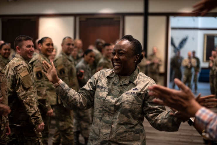 U.S. Air Force Master Sgt. Zina Dromov, 60th Air Mobility Wing Commander's Action Group superintendent, is lauded by her peers during a celebration commending the master sergeants selected to promote to the rank of senior master sergeant March 4, 2020, on Travis Air Force Base, California. Dromov was one of the base's 23 master sergeants to attain the new rank.