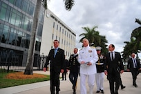 Jair Bolsonaro walks with Navy Adm. Craig Faller in Miami.