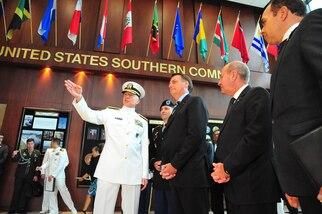 Jair Bolsonaro talks with Navy Adm. Craig Faller in Miami.