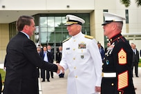 Brazilian President Jair Bolsonaro arrives at U.S. Southern Command headquarters and is greeted by Navy Adm. Craig Faller.