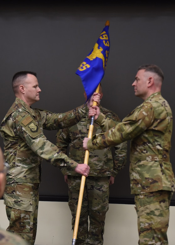 U.S. Air Force Lt. Col. Brian Jones (right), 193rd Special Operations Support Squadron commander, accepts command from Lt. Col. Dereck Rogers,193rd Special Operations Group commander, during a change of command ceremony March 7, 2020, in Middletown, Pennsylvania. The ceremony began with preliminary honors and ended with the symbolic passing of the guidon. (U.S. Air National Guard photo by Staff Sgt. Rachel Loftis/Released)