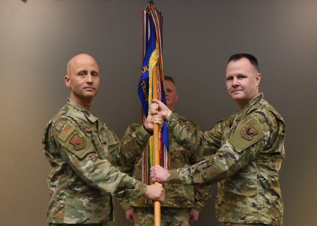 U.S. Air Force Lt. Col. Dereck Rodgers (right),193rd Special Operations Group commander accepts a guidon from Col. Terrence Koudelka,193rd Special Operations Wing commander, during an assumption of command ceremony March 7, 2020, in Middletown, Pennsylvania. The ceremony began with preliminary honors and ended with the symbolic passing of the guidon. (U.S. Air National Guard photo by Staff Sgt. Rachel Loftis/Released)