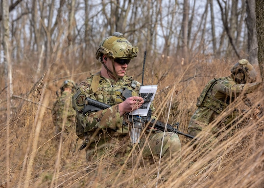 U.S. Air Force Senior Airman Anthony Severo, 148th Air Support Operations Squadron, Tactical Air Control Party Specialist, relays information as part of a training exercise at Fort Indiantown Gap, Feb. 9, 2020, in Annville, Pennsylvania. Field training exercises allow Airmen the opportunity to showcase and hone their skills to ensure they are successful when in real-world situations. (U.S. Air National Guard photo by Staff Sgt. Rachel Loftis/Released)