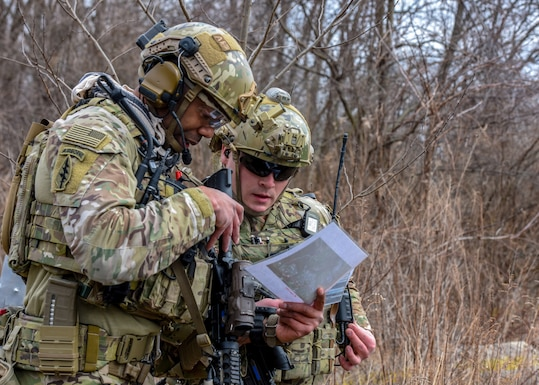 U.S. Air Force Staff Sgt. Kerry Martin (left) and Senior Airman Anthony Severo, 148th Air Support Operations Squadron, Tactical Air Control Party Specialists, look over information as part of a training exercise at Fort Indiantown Gap, Feb. 9, 2020, in Annville, Pennsylvania. Field training exercises allow Airmen the opportunity to showcase and hone their skills to ensure they are successful when in real-world situations. (U.S. Air National Guard photo by Staff Sgt. Rachel Loftis/Released)