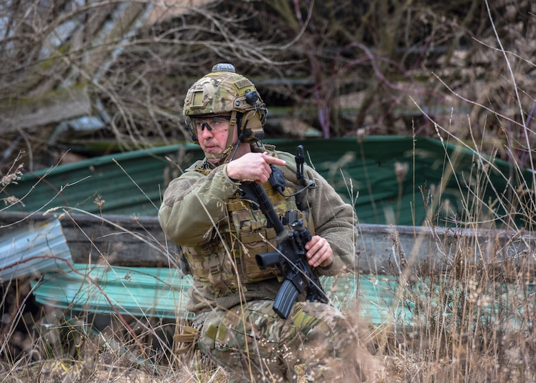 U.S. Air Force Staff Sgt. James Montague, 148th Air Support Operations Squadron, Tactical Air Control Party Specialist, motions to members of his unit during a training exercise at Fort Indiantown Gap, Feb. 9, 2020, in Annville, Pennsylvania. Field training exercises allow Airmen the opportunity to showcase and hone their skills to ensure they are successful when in real world situations. (U.S. Air National Guard photo by Staff Sgt. Rachel Loftis/Released)