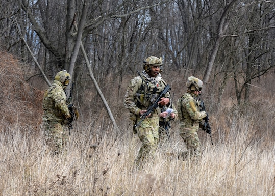 U.S. Air Force Tactical Air Control Party Specialists with the 148th Air Support Operations Squadron survey an area Feb. 9, 2020, as part of a training exercise at Fort Indiantown Gap, Annville, Pennsylvania. The training exercise tested the Airmen on practical applications of shooting, moving, communicating and medical response. (U.S. Air National Guard photo by Staff Sgt. Rachel Loftis/Released)