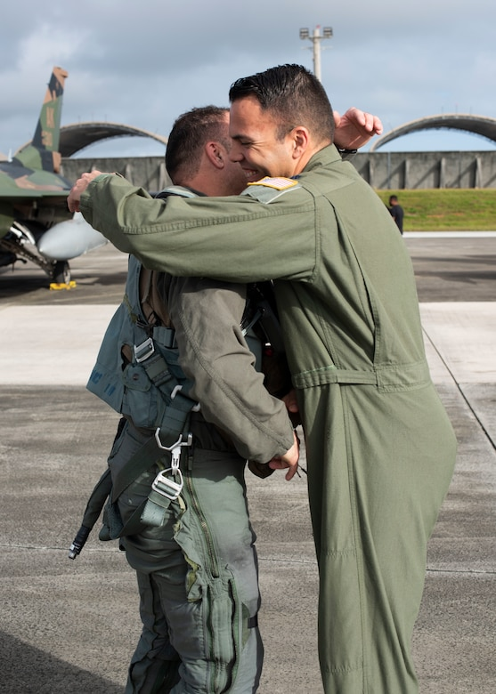 Lt. Col. Julio Rodriguez (left) and his brother Lt. Col. Antonio Rodriguez (right) hug before Julio's flight in an F-16C Fighting Falcon, February 27, 2020 at Andersen Air Force Base, Guam.