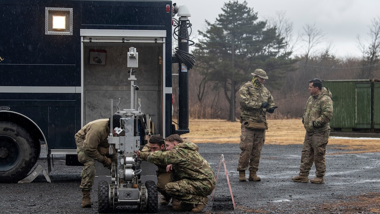 U.S. Airmen with the 35th Civil Engineer Squadron Explosive Ordnance Disposal team inspect an F6A robot at Misawa Air Base, Japan, March 3, 2020. The robot helps EOD Airmen dispose of potential explosives without putting human life at risk. (U.S. Air Force photo by Airman 1st Class China M. Shock)