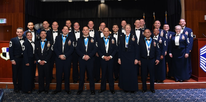52nd Fighter Wing chief master sergeant selectees pose for a group photo with 52 FW chief master sergeants at the annual Chief Recognition Ceremony at Spangdahlem Air Base, Germany, Mar. 6, 2020. The selectees celebrated moving to the rank of chief master sergeant and enjoyed a dinner with family and friends. (U.S. Air Force photo by Airman 1st Class Alison Stewart)