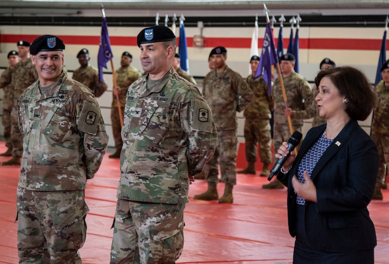 The honorable Nellie Gorbea, Rhode Island Secretary of State, right, offers words of thanks to both Col. Bradley A. Heston, center, and Col. Carlos E. Gorbea, for their service to the United States of America, during the 361st Civil Affairs Brigade change of command ceremony held on Kleber Kaserne in Kaiserslautern, Germany, March 7, 2020.