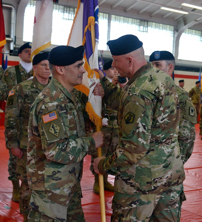 Brig. Gen. Michael T. Harvey, right, commander of the 7th Mission Support Command, passes the unit colors to Col. Carlos E. Gorbea, incoming commander of the 361st Civil Affairs Brigade, during a change of command ceremony held on Kleber Kaserne in Kaiserslautern, Germany, March 7, 2020. (Photo by Elisabeth Paqué, Visual Information Specialist)