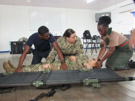 Sgt. Arielle Tango, a Florida Army Guard medic with the 256th Medical Company Area Support (MCAS), shares the proper technique to transport a casualty with members of Guyana's defense force and coast guard. Tango was part of a Florida Army Guard team that traveled to Guyana in December as part of Florida's State Partnership Program to help strengthen military medical readiness with the country.