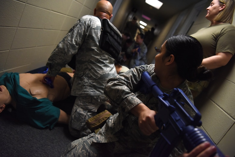 Tactical Combat Casualty Course students perform their final evaluation inside the Locker House at Keesler Air Force Base, Mississippi, Feb. 20, 2020. The TCCC is replacing self-aid and buddy care to better prepare medics for deployed environments. (U.S. Air Force photo by Senior Airman Suzie Plotnikov)