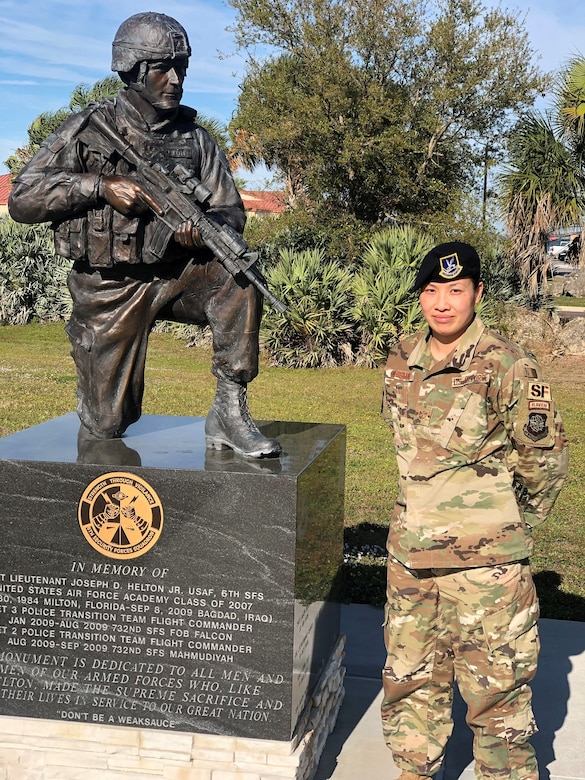 Tech. Sgt. Amy Chismar, 6th Security Forces Squadron, stands next to a memorial dedicated to 1st Lt. Joseph D. Helton a security forces officer assigned to the 6th Security Forces Squadron, who was killed during his deployment to Iraq in 2009. (Courtesy photo)