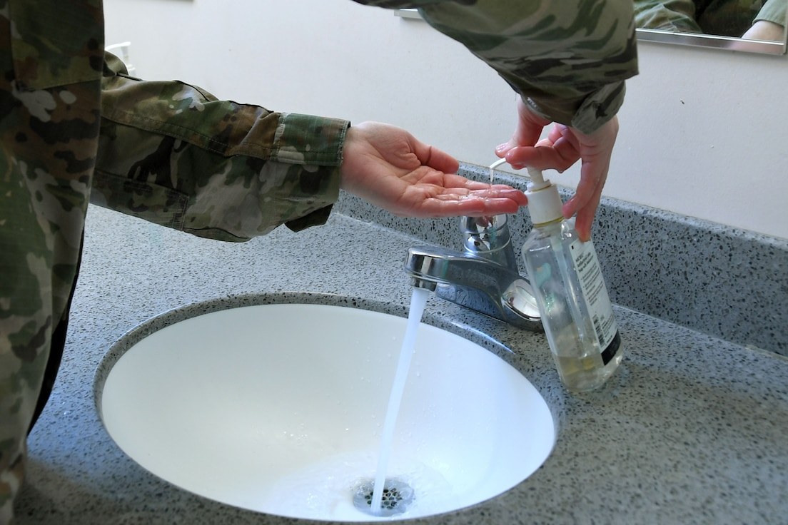A North Carolina Air National Guardsmen washes her hands to demonstrate safe practices to prevent the spread of Coronavirus during a drill weekend, Mar. 06, 2020 at the North Carolina (N.C.) Air National Guard Base, Charlotte Douglas International Airport.  The Coronavirus, or COVID19, is spreading across the U.S.; several states, including North Carolina, have reported their first cases. Both Wake and Chatham Counties in N.C. have 2 confirmed cases of the virus.