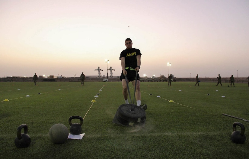 Spc. Griffen Vaughn drags a hefty load as part of the Army Combat Fitness Test event during the Task Force Spartan Best Warrior Competition held February 25-28th at Camp Buehring, Kuwait. (U.S. Army photo by Spc. Kara Hanuschewicz)