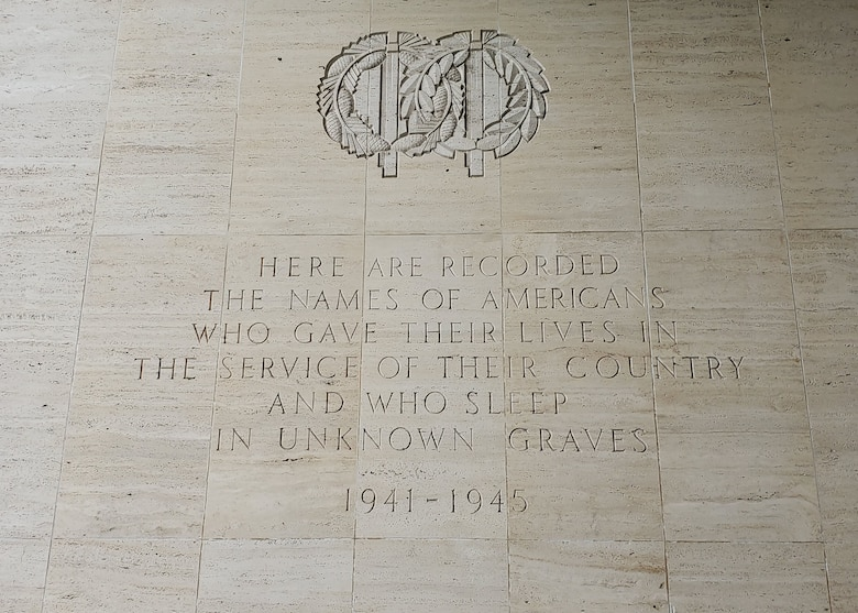 A marble wall with a quote engraved in it.