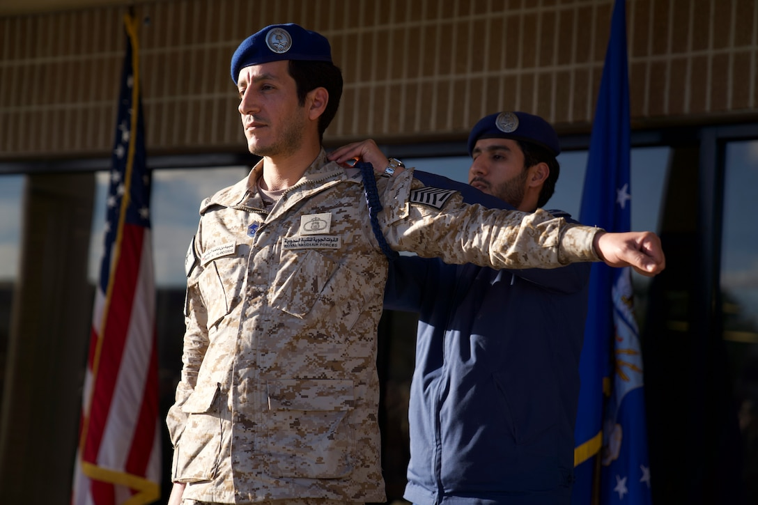Royal Saudi air force Senior Master Sgt. Obaid Al-Bogami, 81st Training Support Squadron Military Training Leader course student, recieves a blue rope during the MTL course graduation ceremony outside the Levitow Training Support Facility at Keesler Air Force Base, Mississippi, March 5, 2020. Al-Bogami was the first international student the MTL schoolhouse graduated in approximately three years. (U.S. Air Force photo by Airman 1st Class Spencer Tobler)