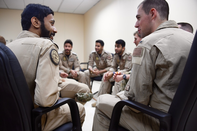 U.S. Air Force and Royal Saudi Air Force E-3 Sentry aircrew members discuss a variety of mission topics during a meet and greet on Prince Sultan Air Base, Kingdom of Saudi Arabia, March 3, 2020. The E-3 and its aircrew are forward deployed to PSAB from Al Dhafra Air Base, United Arab Emirates, as part of an agile combat employment mission meant to test their ability to conduct missions in the region from an austere location. (U.S. Air Force photo by Tech Sgt. Michael Charles)