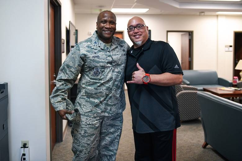 Col. Devin Pepper, 460th Space Wing commander, and Alan Muriera, 460th Medical Group health promotion manager, pose for a photo, March 5, 2020, at the Human Performance Center at Buckley Air Force Base, Colo.