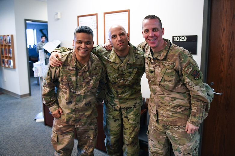From left to right, Master Sgt. Socrates Plantilla, 460th Medical Group dental clinic flight chief, Chief Master Sgt. Robert Devall, 460th Space Wing command chief, and Lt. Col. Christian Smith, 460th Medical Group medical operations commander, pose for a photo, March 5, 2020, at the Human Performance Center at Buckley Air Force Base, Colo.