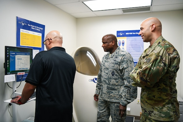 Alan Muriera, 460th Medical Group health promotion manager, begins inputting information into a computer with Col. Devin Pepper, 460th Space Wing commander, Chief Master Sgt. Robert Devall, 460th Space Wing command chief, March 5, 2020, at the Human Performance Center at Buckley Air Force Base, Colo.