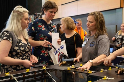 Michelle Berger (right) represents Puget Sound Naval Shipyard & Intermediate Maintenance Facility at the 2019 Seattle Women in Trades fair.