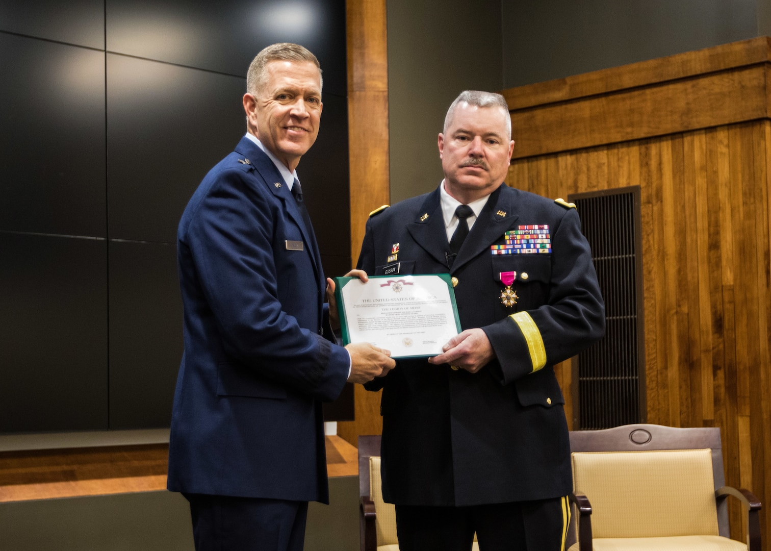 Brig. Gen. Michael Glisson of Festus, Missouri, stands with Brig. Gen. Richard Neely of Springfield, Illinois, the Adjutant General of the Illinois National Guard, after being presented the Legion of Merit at his retirement ceremony March 7, at the Illinois Military Academy in Springfield, Illinois.