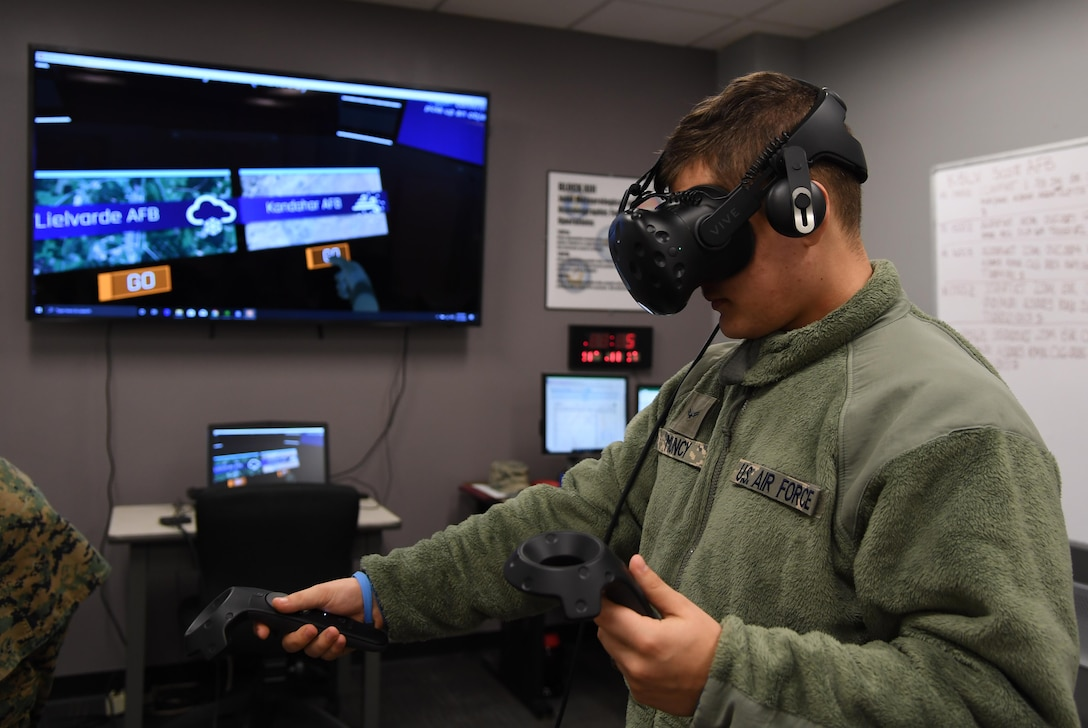 U.S. Air Force Airman 1st Class Ethan Muncy, 335th Training Squadron student, uses virtual reality to observe weather patterns inside the Joint Weather Training Facility at Keesler Air Force Base, Mississippi, Jan. 27, 2020. The weather apprentice course, which graduated 650 students this past year, takes 151 academic days to complete. Approximately 7,400 students go through the 335th TRS's 13 Air Force Specialty Codes each year. (U.S. Air Force photo by Kemberly Groue)