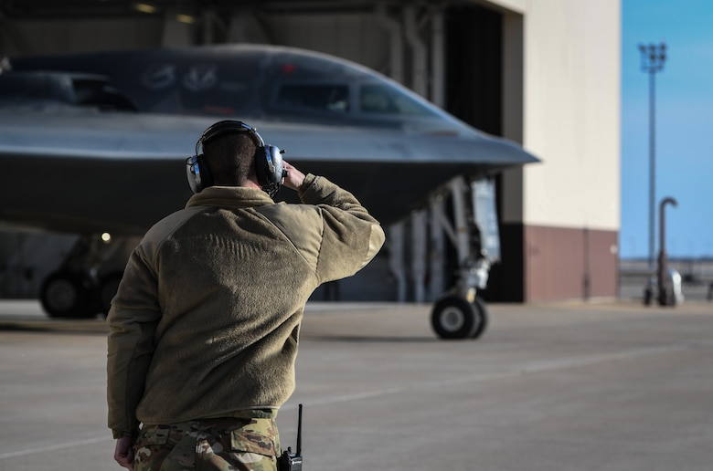 """U.S. Air National Guard Tech. Sgt. Justin Aeckerle, a B-2 crew chief assigned to the 131st Maintenance Squadron, salutes B-2 Spirit pilot before takeoff at Whiteman Air Force Base, Missouri, March 8, 2020. The B-2 """"Spirit of Washington"""" launched from Whiteman AFB to support U.S. Strategic Command Bomber Task Force operations in Europe. The 131s Bomb Wing's 131st MXS is the total-force partner unit to the 509th Bomb Wing. (U.S. Air Force photo by Tech. Sgt. Alexander W. Riedel)"""