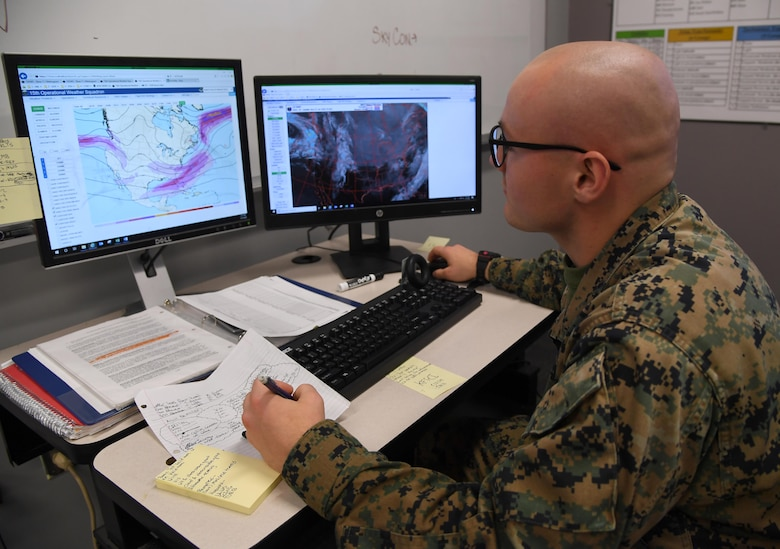 U.S. Marine Corps Lance Cpl. Hayden Weiss, Keesler Marine Detachment student, conducts a weather analysis inside the Joint Weather Training Facility at Keesler Air Force Base, Mississippi, Jan. 27, 2020. The weather apprentice course, which graduated 650 students this past year, takes 151 academic days to complete. Approximately 7,400 students go through the 335th TRS's 13 Air Force Specialty Codes each year. (U.S. Air Force photo by Kemberly Groue)