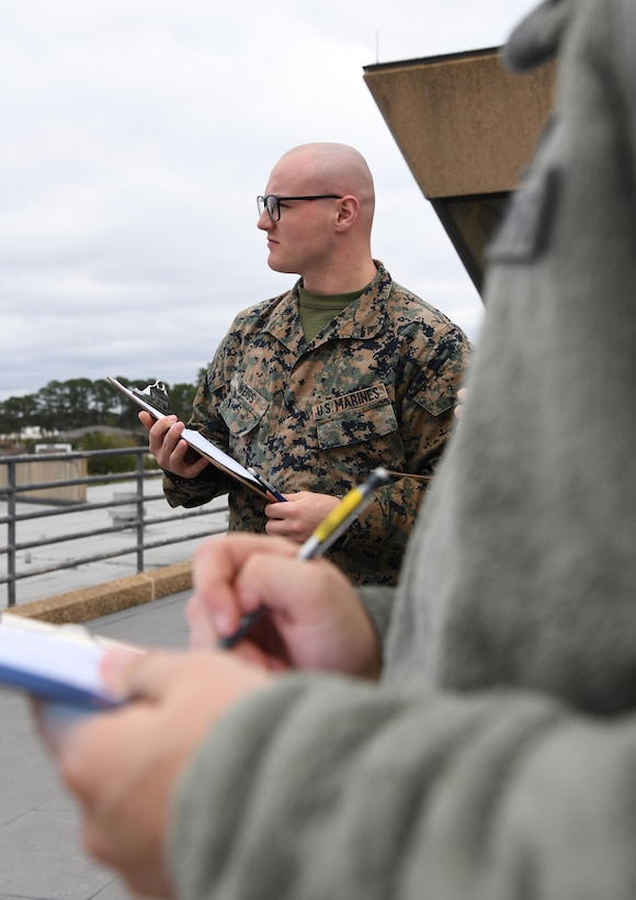 U.S. Marine Corps Lance Cpl. Hayden Weiss, Keesler Marine Detachment student, records a weather observation on top of the Joint Weather Training Facility at Keesler Air Force Base, Mississippi, Jan. 27, 2020. The weather apprentice course, which graduated 650 students this past year, takes 151 academic days to complete. Approximately 7,400 students go through the 335th TRS's 13 Air Force Specialty Codes each year. (U.S. Air Force photo by Kemberly Groue)