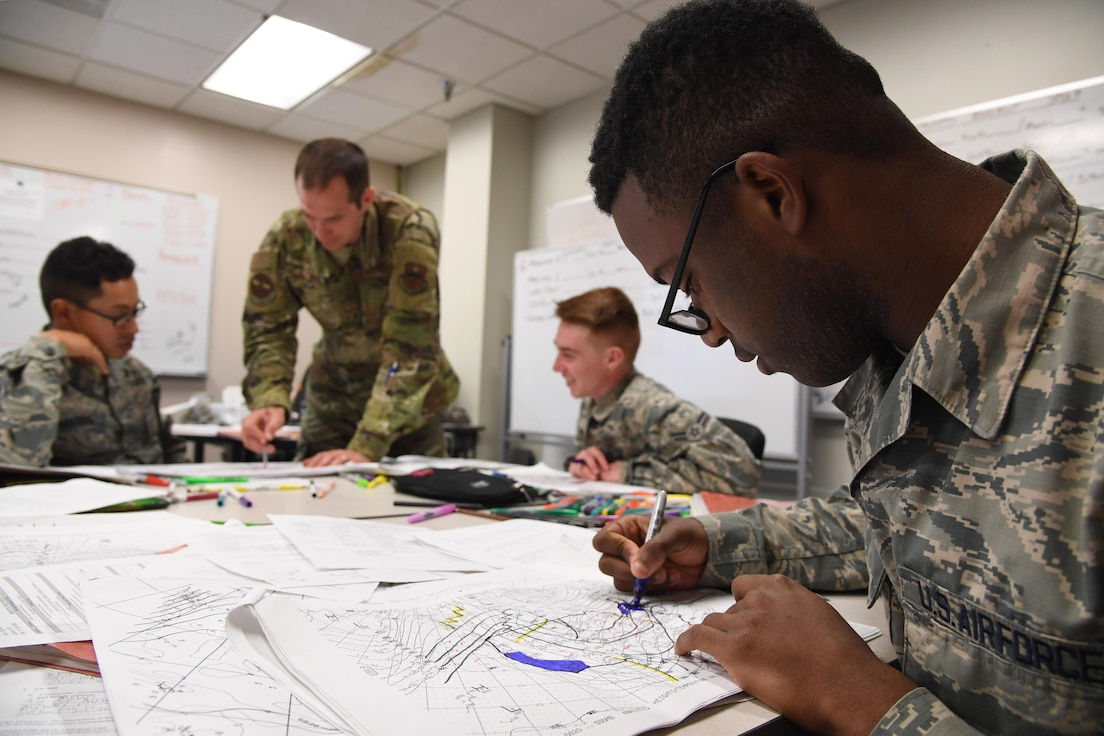 U.S. Air Force Airman 1st Class Agyei Butler, 335th Training Squadron instructor, plots data on weather charts used for training inside of the Joint Weather Training Facility at Keesler Air Force Base, Mississippi, Jan. 27, 2020. The weather apprentice course, which graduated 650 students this past year, takes 151 academic days to complete. Approximately 7,400 students go through the 335th TRS's 13 Air Force Specialty Codes each year. (U.S. Air Force photo by Kemberly Groue)