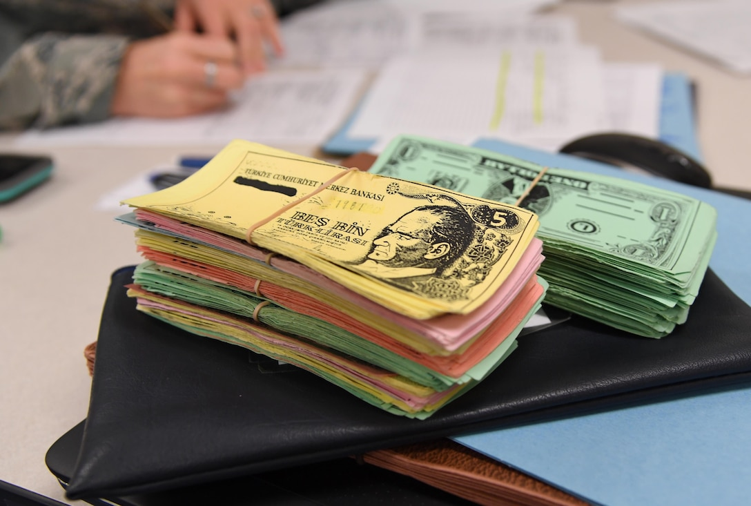 Stacks of play money is displayed on a desk inside Allee Hall at Keesler Air Force Base, Mississippi, Feb. 3, 2020. The finance management course, which graduated 220 students this past year, takes nine academic days to complete. Approximately 7,400 students go through the 335th TRSs 13 Air Force Specialty Codes each year. (U.S. Air Force photo by Kemberly Groue)