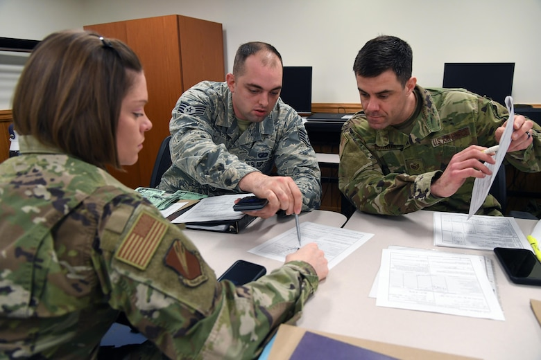 U.S. Air Force Staff Sgts. Briana Lutes, Brandon Arp and Jeffery Barron, 335th Training Squadron students, complete class work for the finance management course inside Allee Hall at Keesler Air Force Base, Mississippi, Feb. 3, 2020. This course, which graduated 220 students this past year, takes nine academic days to complete. Approximately 7,400 students go through the 335th TRS's 13 Air Force Specialty Codes each year. (U.S. Air Force photo by Kemberly Groue)