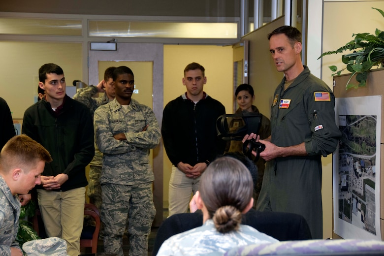 Senior Master Sgt. Brian Mizula, 733rd Training Squadron instructor flight engineer, explains C-5M Super Galaxy aircraft training to members of the Air Force Reserve Officer Training Corps Detachment 840 with Texas State University at Joint Base San Antonio-Lackland, March 3, 2020.