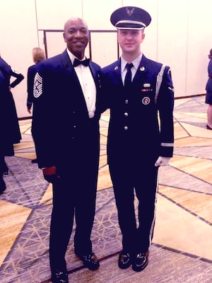 A1C Schneck posing with Chief Master Sergeant of the Air Force