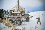 U.S. Marine Corps Cpl. Jonathan Savala loads a Utility Task Vehicle during exercise Northern Viper on Yausubetsu Training Area, Hokkaido, Japan, Feb. 4, 2020. Personnel currently assigned to the Logistics Combat Element for exercise Northern Viper train in austere environments to prepare units for all weather conditions. Northern Viper is a regularly scheduled training exercise that is designed to enhance the interoperability of the U.S. and Japan Alliance by allowing Marine Air-Ground Task Forces from III Marine Expeditionary Force to maintain their lethality and proficiency in MAGTF Combined Arms Operations in cold weather environments. Savala, a native of St. Louis, Missouri, is a vehicle recovery operator with Motor Transport Company, 3rd Transportation Support Battalion, Combat Logistics Regiment 3, 3rd Marine Logistics Group. (U.S. Marine Corps photo by Lance Cpl. Terry Wong)