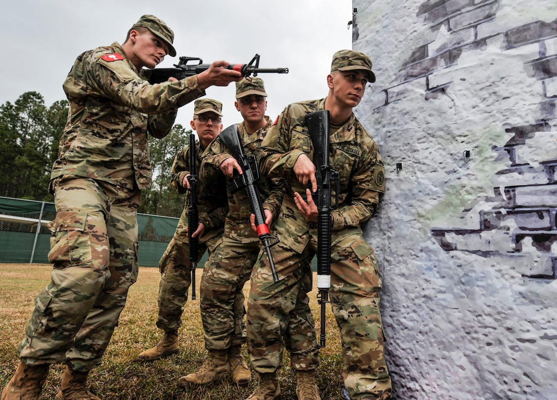 Citadel cadets simulate clearing a room at the Naval Weapons Station Charleston, Joint Base Charleston, S.C., March 3, 2020.