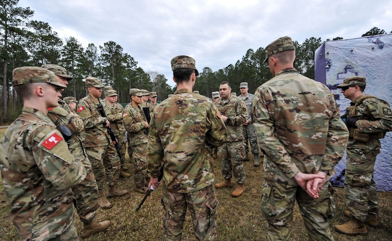 Tech. Sgt. Christopher Marino, 628th Security Forces Squadron flight sergeant, briefs cadets from the Citadel during a joint training exercise at the Naval Weapons Station Charleston, Joint Base Charleston, S.C., March 3, 2020.
