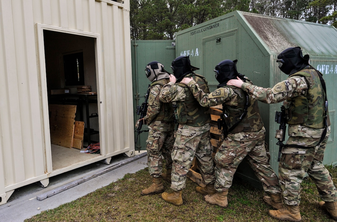 Cadets from the Citadel prepare to enter a shoot house for a live-fire exercise at the Naval Weapons Station Charleston, Joint Base Charleston, S.C., March 3, 2020.