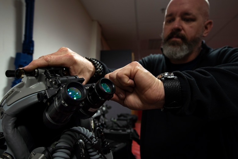 Bill Talton, 52nd Operations Support Squadron aircraft survival equipment repairer, clears out settings on night-vision goggles at Spangdahlem Air Base, Germany, March 4, 2020. Pilots adjust the goggles to match their own eyesight. The 52nd OSS Aircrew Flight Equipment flight is responsible for taking care of all gear pilots need, such as survival kits, parachutes, anti-g suits, and helmets. (U.S. Air Force photo by Senior Airman Valerie R. Seelye)